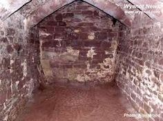 A normal photograph of the inside of Goodrich Castle Dungeon taken at 15:05 on 1 March 2003