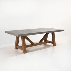 Dine in rustic-modern elegance with our most popular dining table -- BOXHILL's Raw Concrete Trestle Dining Table! The eye-catching trestle leg design lends a feeling of both permanence and nostalgia, while the reclaimed teak helps to ground the look of the raw concrete top. See all of our high-quality products at www.shopboxhill.com