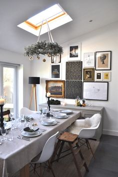 eclectic dining room by sarah & bendrix (I'm liking the black canvases on the wall with the white lettering or handwriting.)