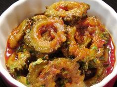 Explore the exotic taste of Onion(Pyaz) and Karela (Bitter Gourd) Sabzi Recipe. This is a delicious and simple to cook recipe made from bitter gourd and onions. Onions and bitter gourd are the most nutritious vegetables. Indian Vegetarian Dishes, Indian Dishes, Vegetarian Cooking, Indian Food Recipes, Vegetarian Recipes, Cooking Recipes, Vegetarian Dinners, Cooking Tips, Healthy Recipes