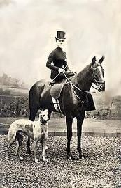 Side saddle rider with her Borzoi