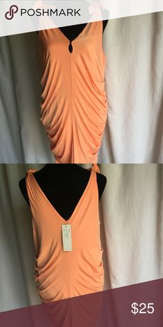 Orange Party Dress This orange dress is great for a night out. Ties at both shoulders. Key hole detail in front. 50% cottony 50% rayon. Size L Dresses Midi