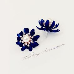 Material: Alloy; Rhinestone; PearlSize: 1 inch x 1 inch (2.5cm x 2.5cm)Colors available: Blue & WhiteCome with a Gift BoxAbsolutely amazing luxurious earrings can be worn or given as a gift for a special occasions, weddings, birthdays, and anniversaries.For White Color, please click on the following link: ^_^https://www.opensky.com/vinsterfashion/merchant/products/blooming-the-earring-white/review