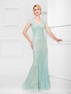 117D69 - Tulle overlay sheath encrusted with hand-beading features slight cap sleeves, front and back V-necklines, satin natural waistband, horsehair hemline. Matching shawl included.