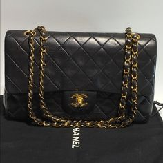 Authentic Chanel Double Flap Bag Available now!! 100% authentic black lambskin double flap bag. It is beautiful and in pristine condition! Dustbag and authenticity card both included! Serial: 1894006 CHANEL Bags Shoulder Bags