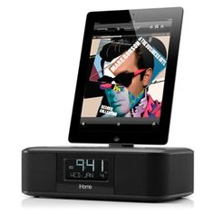 Dual-alarm clock radio stereo speaker system that lets you wake to the music from your iPad