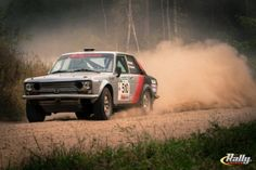 Regional rally drivers Jim Scray and Colin Vickman spray dirt in their 1972 Datsun 510 at the Ojibwe Forests Rally.