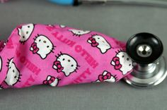 Who doesn't LOVE Hello Kitty? Dress up your everyday scrubs with this CUTE Pink Hello Kitty print Stethoscope Cover. Measuring x this cover will fit any stethoscope and can be slid on easily Stethoscope Accessories, Stethoscope Cover, Pink Hello Kitty, Doctor Gifts, Cord Cover, Pink Fabric, Cute Pink, Mother Gifts, Handmade Gifts