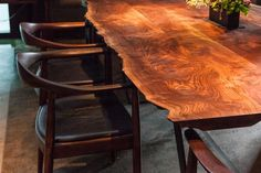 """Live-edge walnut tables (""""polished by hand to be smooth to the touch,"""" say the owners) and comfortable Danish modern-inspired seating."""