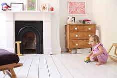 gorgeous kid's room - love the white floor with black fireplace