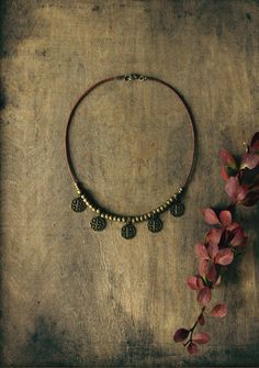 Ananke Jewelry medallion choker boho style necklace with antique gold brass beads and pendants. Handmade high quality brown leather cord. For a natural, bohemian, hippie look. Can be combined with another long necklace for a layered look. It can be a good idea for a gift to a special woman - mother, dauther, friend, sister, girlfriend or wife. As a Birthday present, for Christmas or any other occasion. Visit my Etsy shop for more handmade neckalces and designs: Anankejewelry.etsy.com
