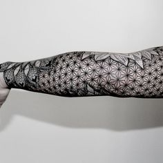 Attractive Geometric Dotwork Tattoo On Sleeve