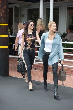 Kendall Jenner and Hailey Baldwin walk hand-in-hand in coordinating denim looks. Get the look here!