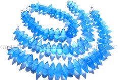 Blue Chalcedony beads In Centre Drilled Dew Drops Faceted #bluechalcedony #bluechalcedonybeads #bluechalcedonybead #bluechalcedonydewdrops #dewdropsbeads #beadswholesaler #semipreciousstone #gemstonebeads #gemrare #beadwork #beadstore #bead