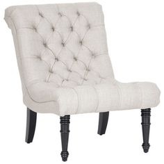Wood accent chair with tufted linen upholstery and foam cushioning. Product: Chair Construction Material: Linen, poly...