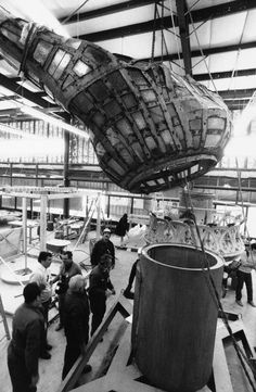 Flame sculpture from the Statue of Liberty is hoisted over a pedestal for a fitting before being shipped to California for an appearance in the New Years Day Rose Bowl Parade in Pasadena, Dec. 16, 1984. The torch and flame of the Statue of Liberty have been in a workshop on Liberty Island after being removed during restoration work. The pedestal will be used to support the flame on the Rose Bowl float. (AP Photo/Dan Cornish) # Visit statueofliberty.org