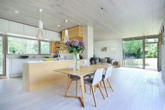 Small dining space with rectangular table and four comfy chairs