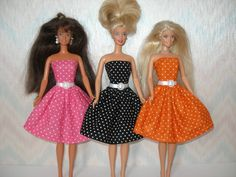 Your choice -- choose 1 - pink, black or orange. 11.5 fashion doll dress is handmade with a black and white polka dot cotton fabric and trimmed with an attached white ribbon belt with white plastic buckle. 1 Dress only--doll is not included. Made in a smoke and pet free home. Save on