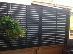 Creative diy flex fence outdoor project idea louvered for Hanging privacy screens for decks