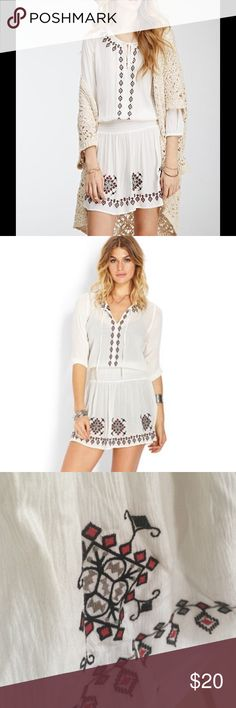 "Boho white peasant dress This dress features a beautiful embroidered design throughout it. It has 3/4 quarter length sleeves. It has a lower waist line, and a measured length of 33"". Never before worn!!! Forever 21 Dresses Mini"