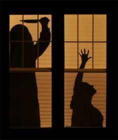 Decorating windows with silhouettes is a spooky way to welcome your guests on Halloween. Besides, it's a simple way. You simply need to cut out some cool shapes from black cardboard, apply them on windows and turn on the lights. These silhouettes could be ghosts, zombies, withes, and any other related to Halloween characters.