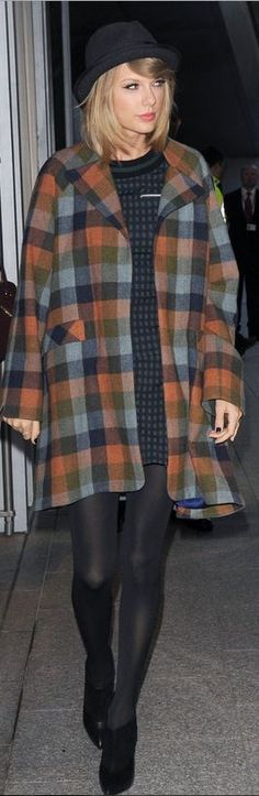 Who made  Taylor Swift's green plaid short sleeve top, black ankle boots, orange plaid coat, gray hat, and print skirt that she wore in London on October 9, 2014