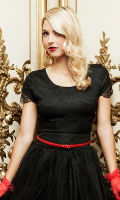 Cascading rows of fine black lace create a blouse so elegant, it's worthy of Hollywood's most glamorous event. Constructed of a smooth liner in black satin topped with a sheath of intricate black lace, the