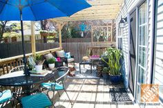Ingredients for the perfect deck: A well-built pergola, sparkly string lights, colorful potted plants, and trendy pillows. Click through for more patio decorating inspiration!