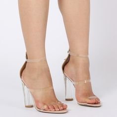 Taking the perspex trend to a whole new level with Amari. With the perspex clear heel and clear triple straps even Cinders herself will be green with envy. With open peeptoe you can flash those newly pedicured tootsies. Featuring zip up the back for ease. Pair these with a figure hugging bodycon with plunging neckline you'll be the hottest belle at the ball.   Heel Height: 4.1\