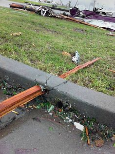 This is the picture that struck me the most in the after math of Joplin Missouri's tornado. I just can't get over how wood can pierce through cement because the force on the tornado is so powerful.