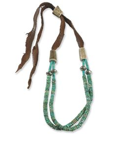 Turquoise and silver beads on a leather strand with elk horn adjusters.