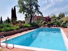 Property in Tuscany, IL GIARDINO E L'OLIVETO. Il Giardino e l'Oliveto is a charming 250 year old villa-farmhouse, which has been beautifully restored by the Anglo-Irish artist/owner. The house is on two floors, built of warm Sienese stone and brick, encircled by wide terracotta terraces, ancient mulberry trees and huge old cypresses, olive groves, lawns and gardens of aromatic shrubs and fragrant herbs.
