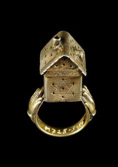 A possibly nineteenth-century Austrian gilt-silver Jewish wedding ring incorporating a symbolic house with a star of David. (The Israel Museum)