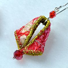 Textile earrings in red and orange with gold