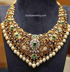 22 Carat gold antique Lotus design necklace with Swan motifs at the center adorned with polki diamonds, emeralds and pearls by PMJ Jewels. Gold Temple Jewellery, Gold Wedding Jewelry, Gold Jewelry, Bridal Jewelry Sets, Gold Bangles, Jewelry Rings, Antique Jewellery Designs, Gold Jewellery Design, Indian Jewelry