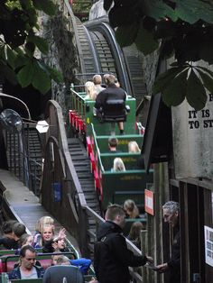 Oldest roller coaster in the world in Tivoli: An operator controls the ride by braking down the hills so it won't gain too much speed! Great job!