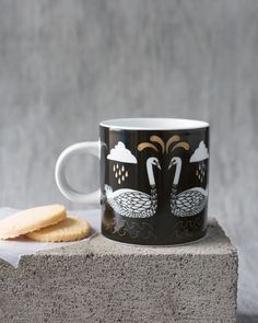 Wild Tale Short Mug - This classic-shaped mug is a surefire conversation starter. Enchanting swans and foliage are arranged in harmonious symmetry with golden metallic highlights. Surefire, Conversation Starters, Swans, Kitchen Dining, Highlights, Metallic, Mugs, Studio, Tableware