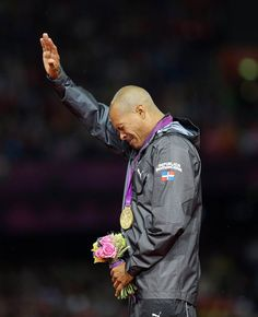 London 2012 Emotional Moments- slideshow Day 10: Felix Sanchez of the Dominican Republic cries after winning gold during the medal ceremony following the men's 400m hurdles final.  (Photo: Robert Ghement / EPA) #NBCOlympics
