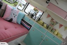 Interior vintage trailer redo. Turquoise and pink with black white checkered floors