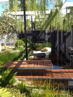 Stunning hanging planters in this Incredible contemporary garden design by Brendan Moar.