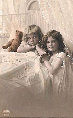 Vintage Postcard ~ Sisters with their Teddy bear.