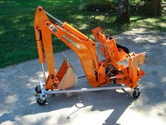 BXpanded Backhoe Dolly makes removal, installation, and storage of your and backhoe a snap. 3 Point Attachments, Tractor Attachments, Small Tractors, Lawn Tractors, Tractor Accessories, Kubota Tractors, Yard Maintenance, Tractor Implements, Rubber Tires