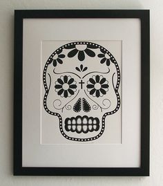 kinda obsessed with day of the dead skulls. i'm getting ready to order one of these.