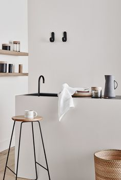 Living the minimalist life - Using ceramics and clean pale colour palettes for this kitchen scheme.