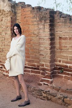 Amanda Murphy in a white sweater dress, loafers. Mario Sorrenti for The NY Times T Style Magazine