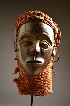 Africa | Mask from the Chokwe people of Angola or DR Congo | Wood, beads, pigment, buttons, zipper, fiber, raffia, cloth, metal, unknown material | Early to mid 20th century