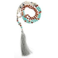 This beautiful mala makes a wonderful meditation tool as well as a stunning necklace. Consisting of rudraksha seeds, turquoise and ocean jasper beads. Mala bead