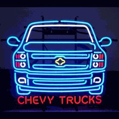 """CHEVY TRUCKS NEON SIGN-NN5CTRUCK  26"""" wide, 22""""high, 4"""" deep  Add a little light to your garage with our Chevy Trucks Neon Sign, featuring multi-colored, hand blown tubing supported on a black, finished metal grid. The Chevy Trucks Neon Sign can be displayed flat on a wall or in a window or alternately be placed upon a shelf."""