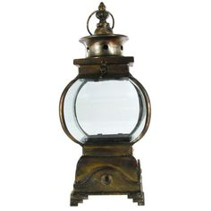 The old-world charm of this Antique Gold Metal & Glass Antique Candle Lantern is too stunning for words. Featuring an authentically antiqued look and a unique rounded shape, this gorgeous metal and glass lantern is the perfect place to display a scented candle, an LED candle, glistening LED lights, and so much more. Customize your decor with stylish accents! $54.95