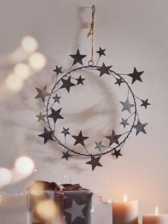 Carefully crafted from lightweight aged zinc, this intricate wreath includes an array of wired posable stars in two different sizes and a simple jute string for hanging. A unique alternative to traditional green wreaths, our rustic star wreath can be bent and shaped into a three dimensional shape for your door and wall, or laid flat as a table top centrepiece.